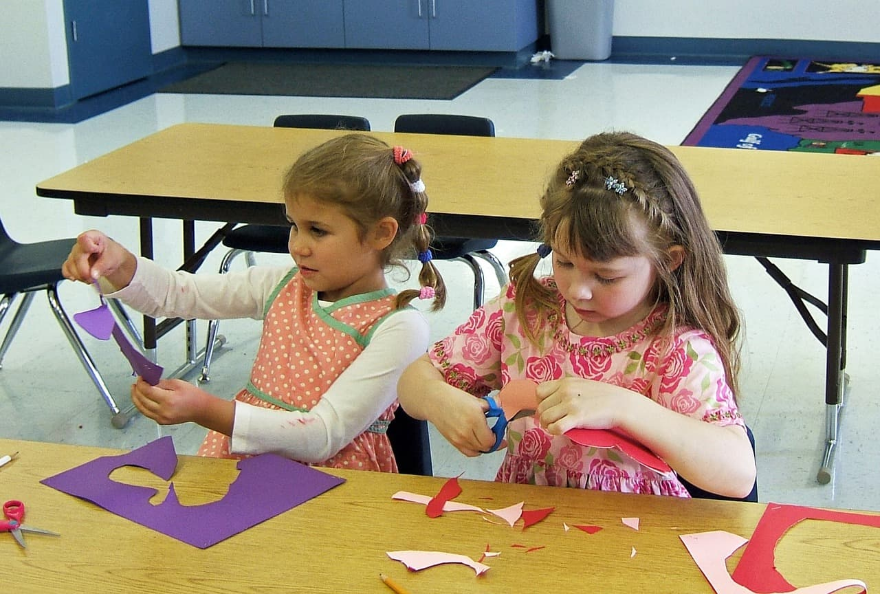 ECE - Development beyond preschool as two girls learn through art.