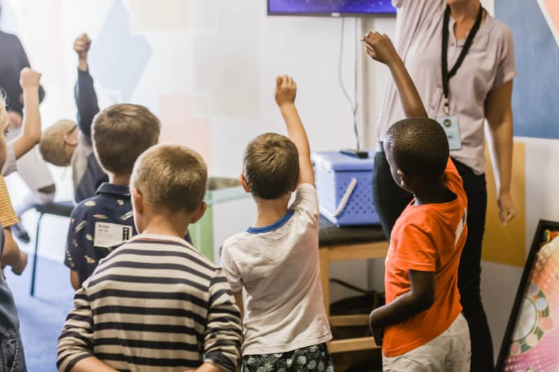 ECE teacher teaches students patience in raising hands and waiting their turn