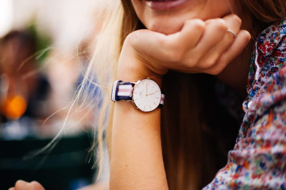 Woman with her chin in her hand wearing a watch