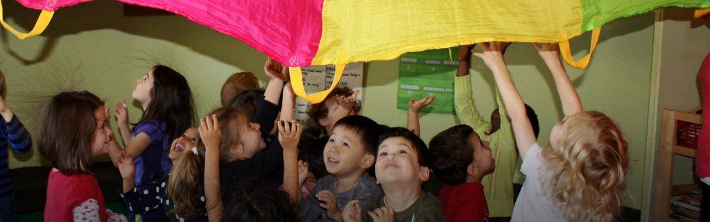 Preschool children playing in a large group