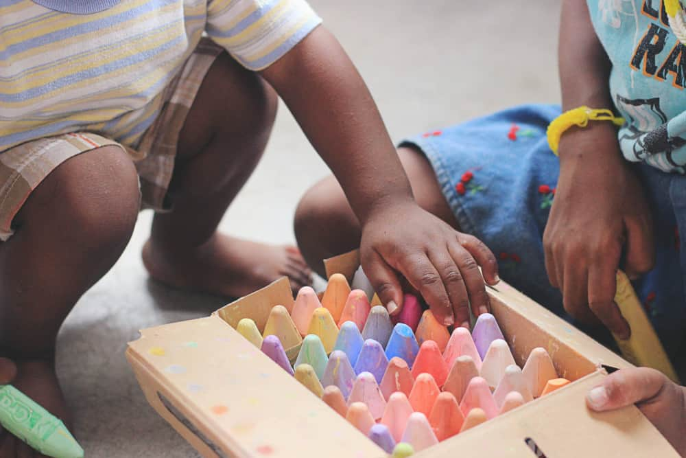 Early Childhood at play - toddlers with color chalk